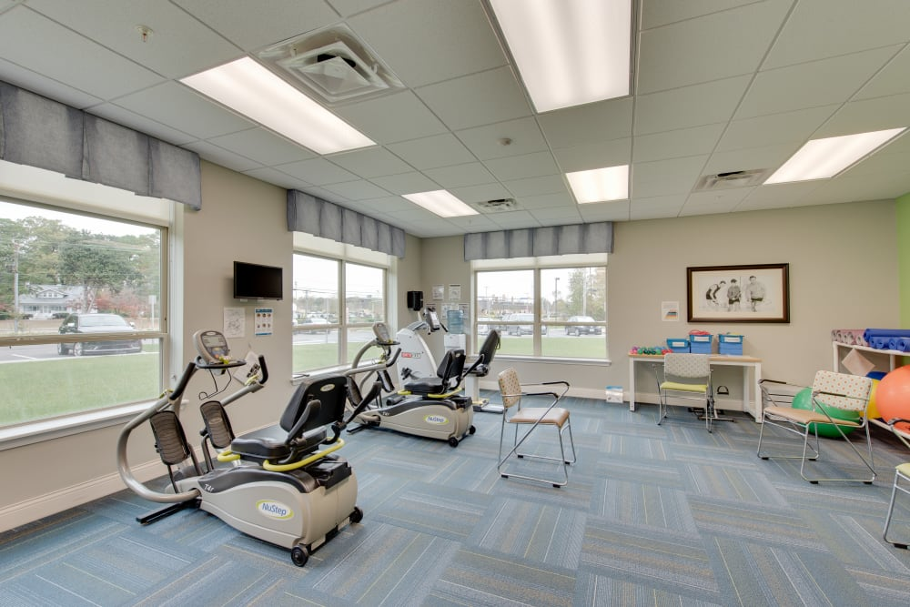 Exercise equipment in the gym at Harmony at Oakbrooke in Chesapeake, Virginia
