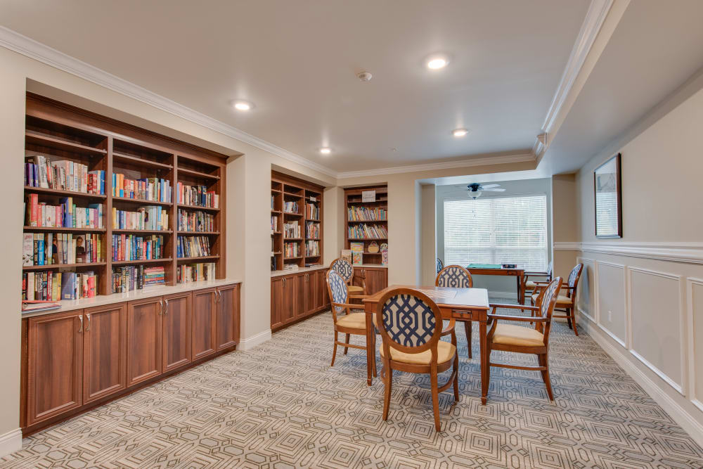 A library with quiet seating at Harmony at Oakbrooke in Chesapeake, Virginia