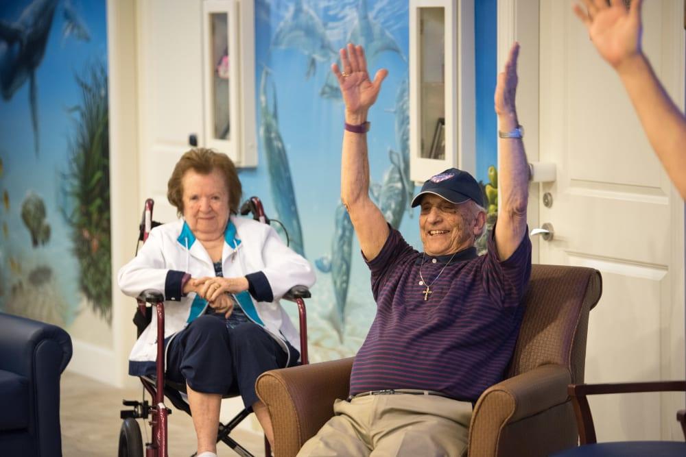 Residents pose for a photo at Inspired Living Alpharetta in Alpharetta, Georgia.