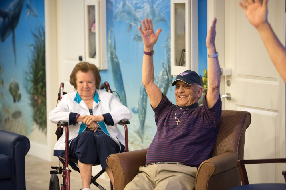 A couple of residents pose for a photo at Inspired Living at Bonita Springs in Bonita Springs, Florida.