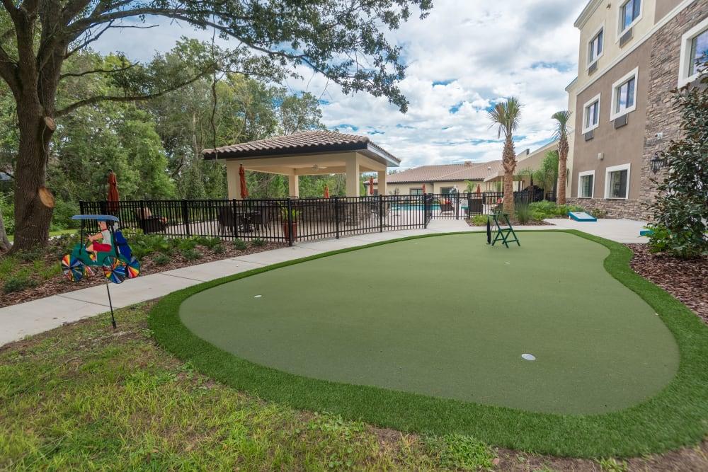 Putting green at Inspired Living Hidden Lakes in Bradenton, Florida