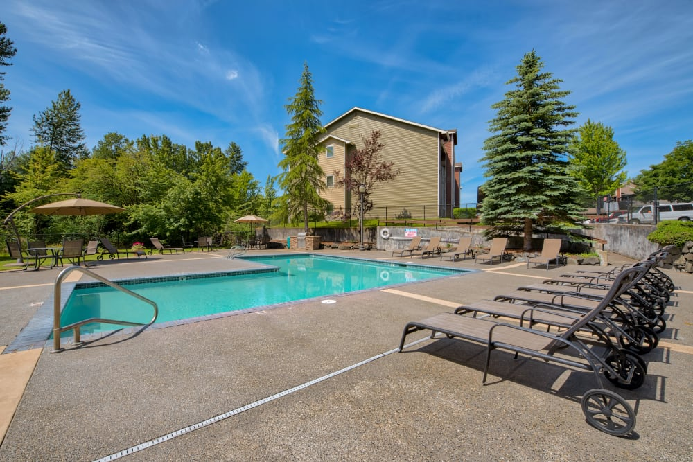 Relaxing swimming pool at Aravia Apartments in Tacoma, Washington