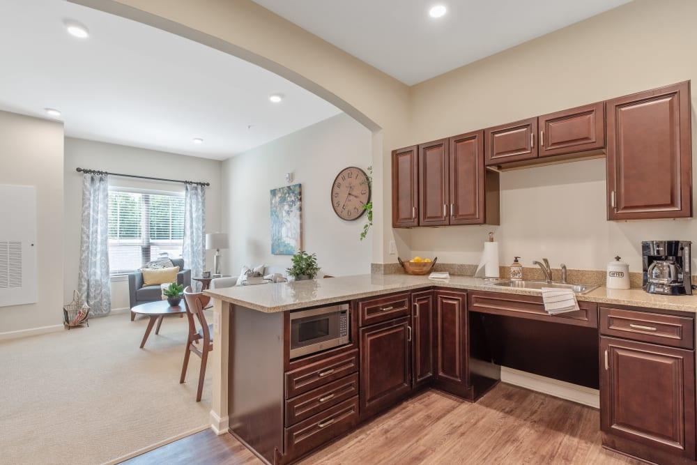 Assisted living apartment kitchen at Harmony at Greensboro in Greensboro, North Carolina