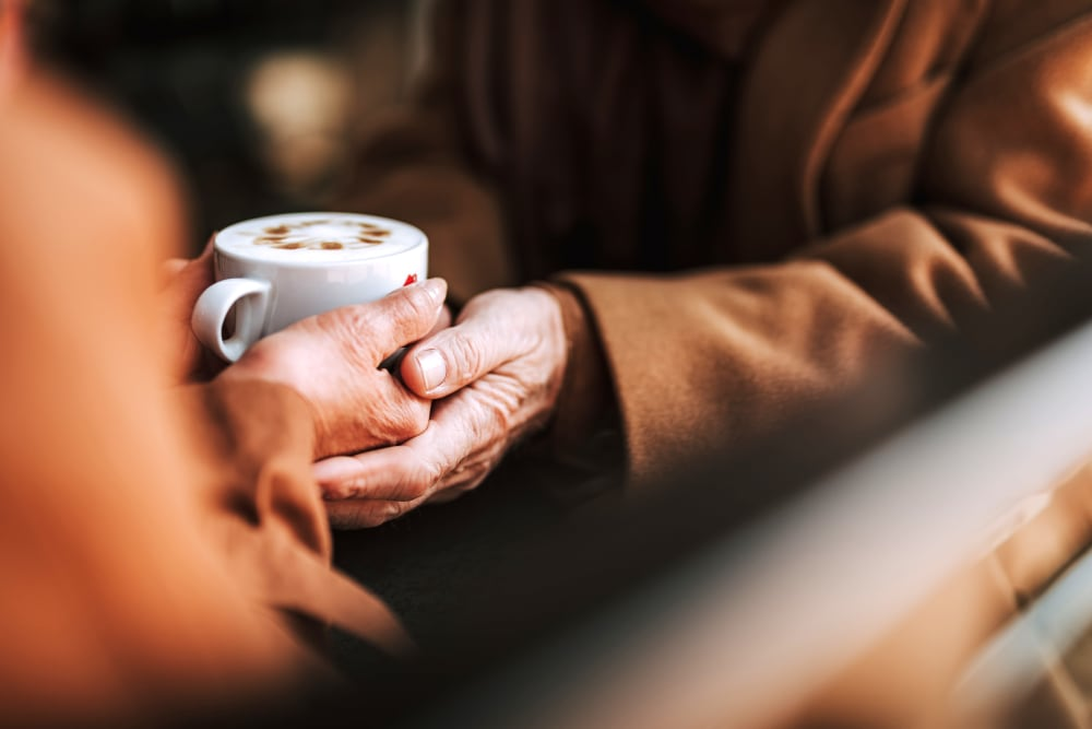 A resident holding a cup of coffee at The Blake at The Grove in Baton Rouge, Louisiana.