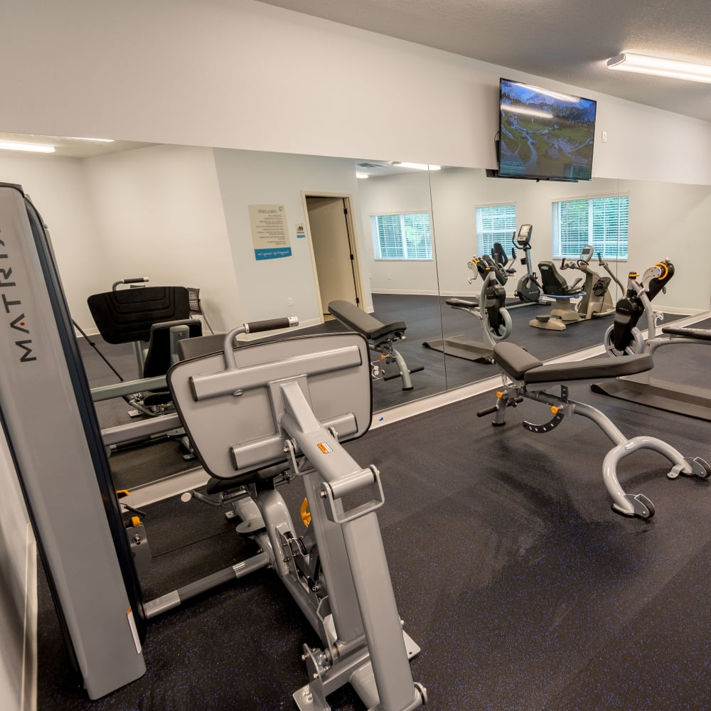 Fitness center with classes at Inspired Living at Royal Palm Beach in Royal Palm Beach, Florida