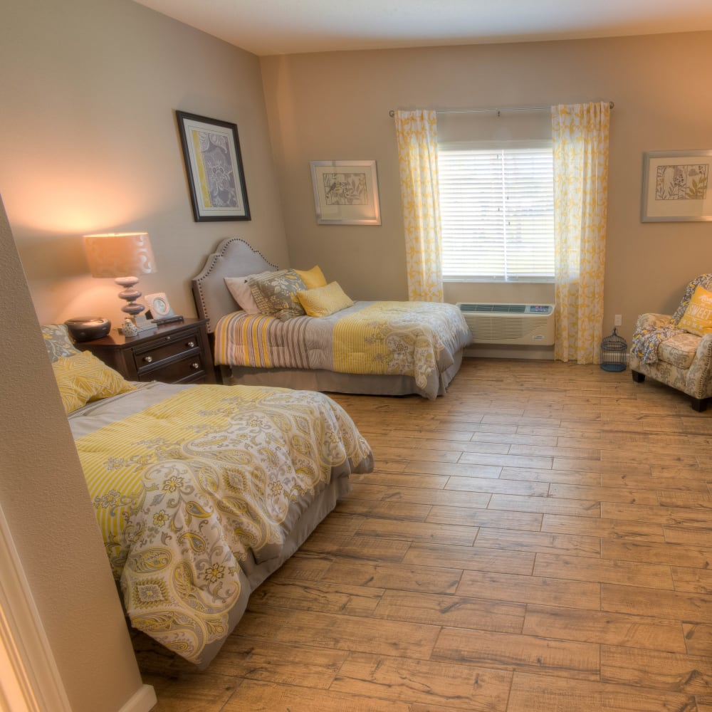 A companion bedroom with hardwood floors at Inspired Living Tampa in Tampa, Florida