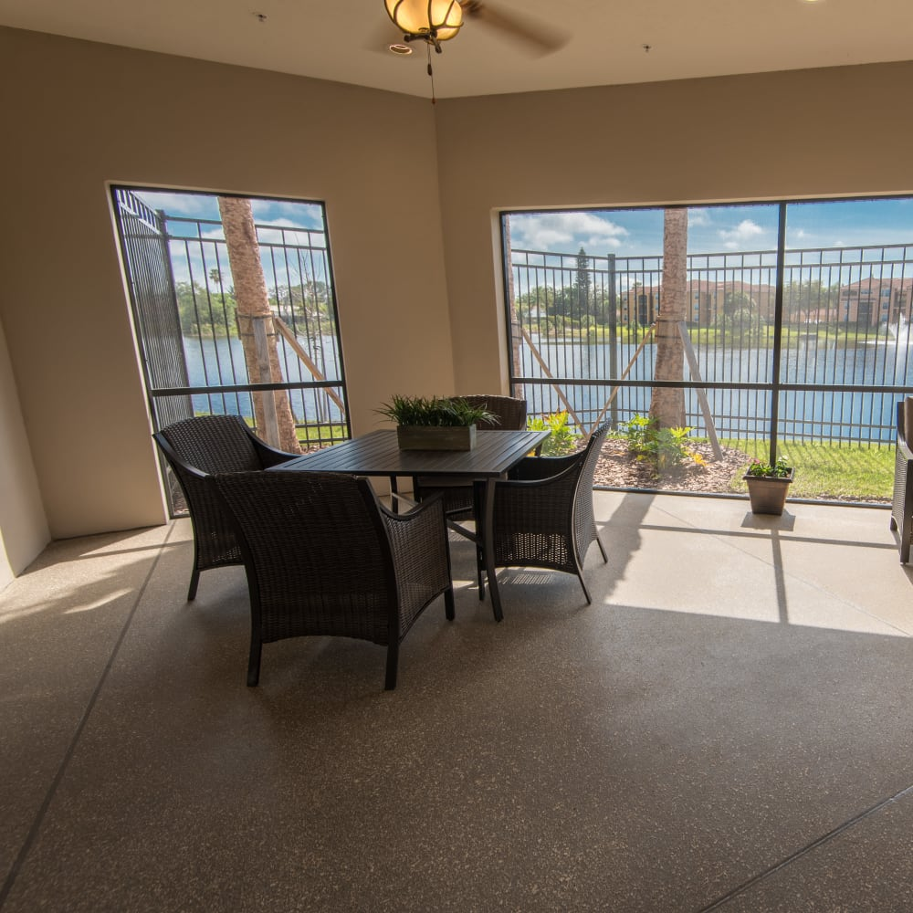 A porch with lake views at Inspired Living in Bonita Springs, Florida.
