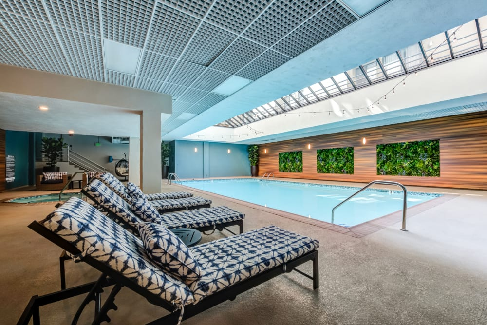 Chaise lounge chairs around the indoor swimming pool at Vue Los Feliz in Los Angeles, California