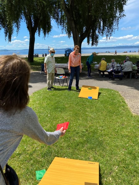 Residents and team members enjoyed some cornhole under the sun.