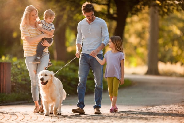 Resident family and their dog enjoying their new home at The Dakota Apartments in Lacey, Washington