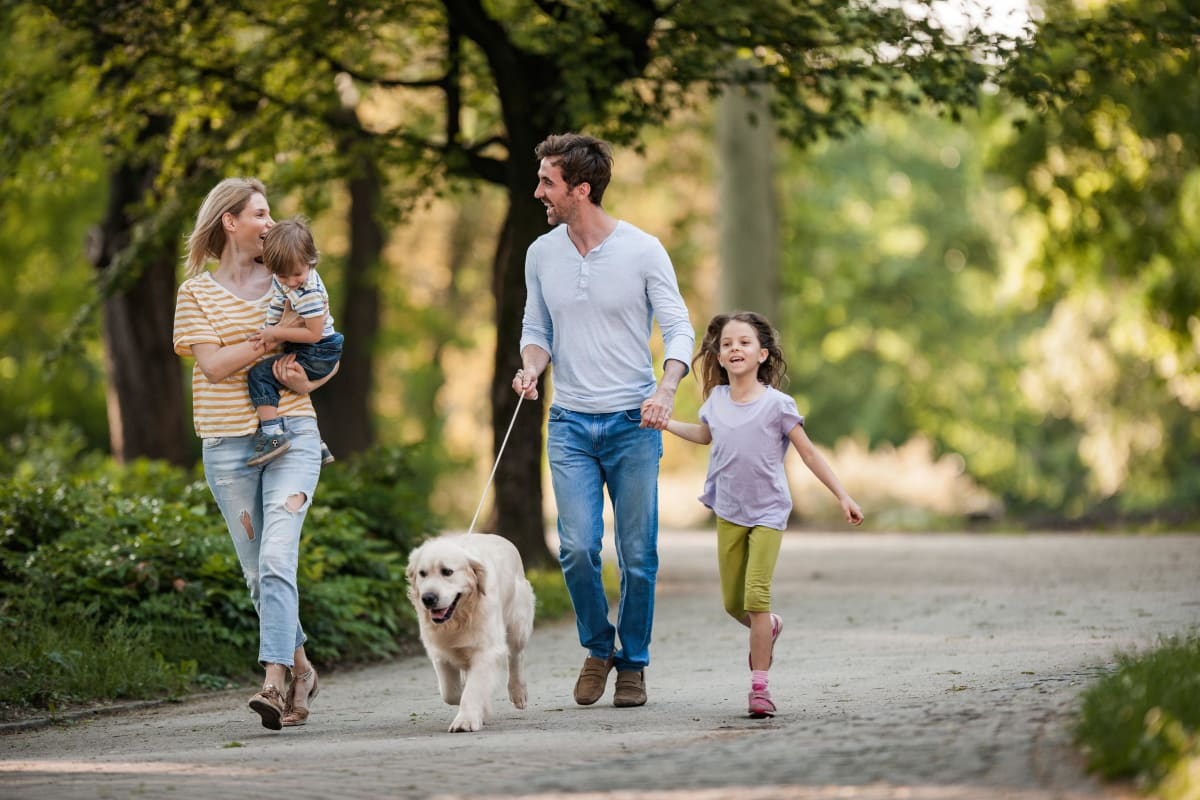 Family taking a walk in nature near The 450 in Lombard, Illinois