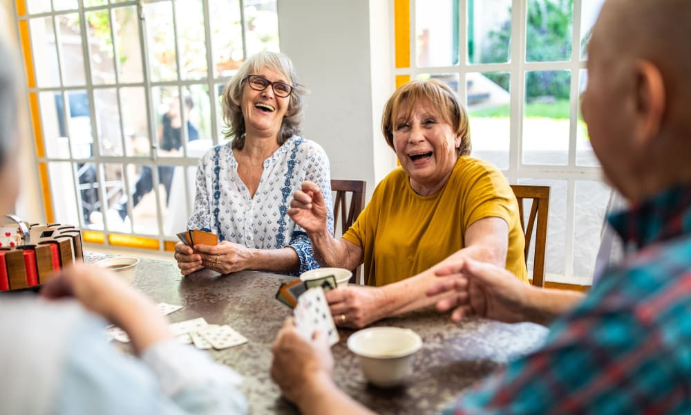 Residents playing a card game at Ativo Senior Living of Prescott Valley in Prescott Valley, Arizona.