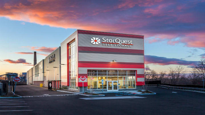 Exterior of a StorQuest Self Storage facility during a sunset.