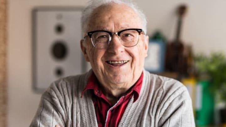 A senior resident smiling