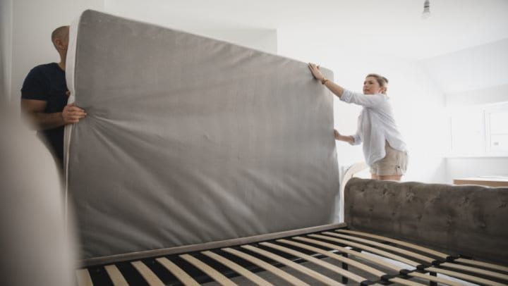couple showing how to store a mattress