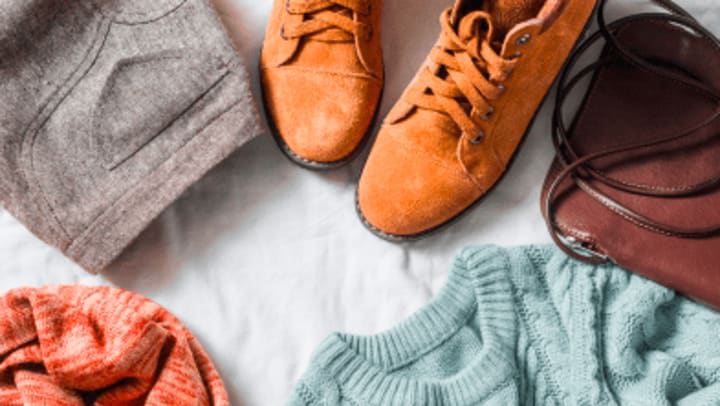 chino pants, orange shoes, teal knitted sweater, bag, and red scarf