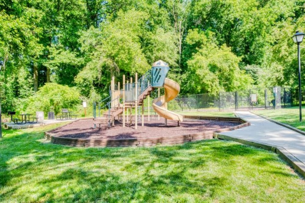 Playground & green space at The Timbers at Long Reach Apartments in Columbia , Maryland