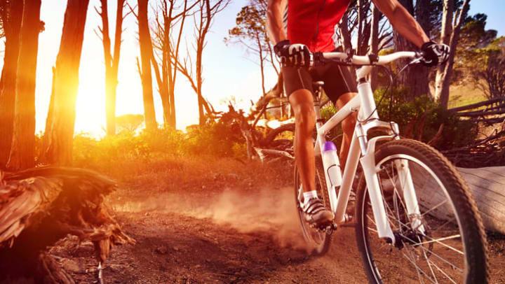 Resident mountain biking near Fusion Apartments in Irvine, California