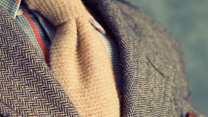 Closeup of retro vintage twill jacket with woolen necktie