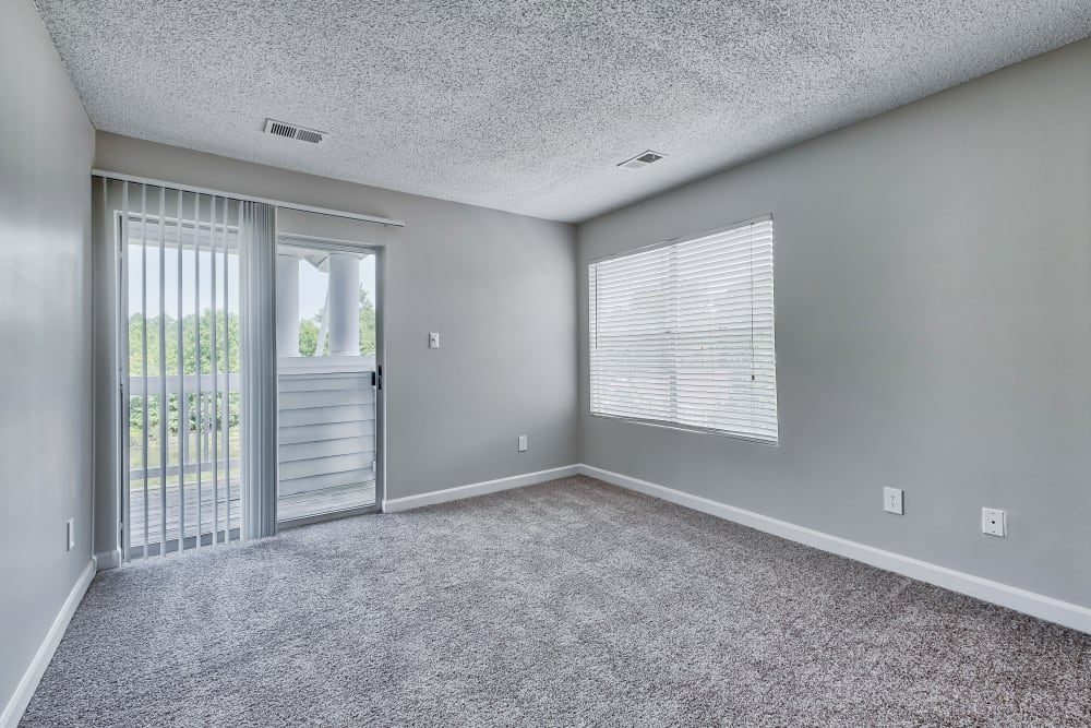 Bedroom with patio access at Copper Mill Apartments
