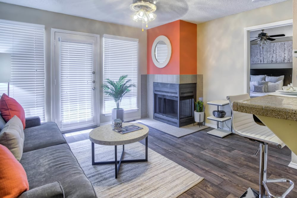 Beautiful living room at Enclave at Water's Edge Apartments in Austin, Texas