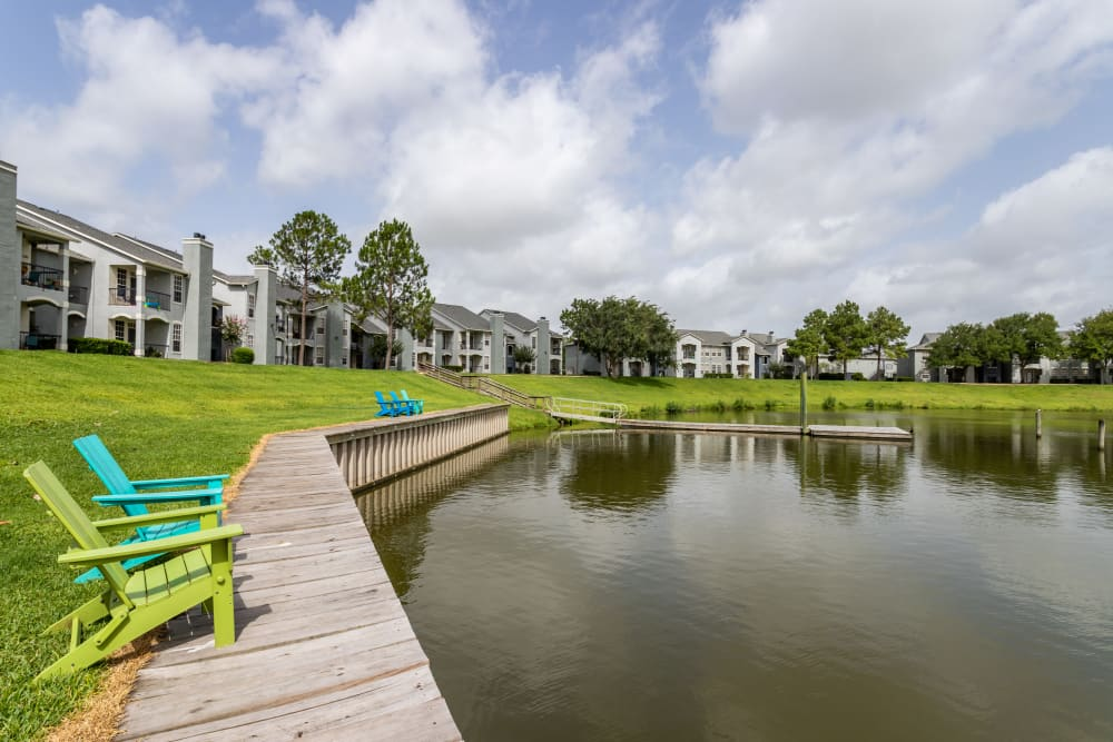 Lawn chairs on the waterside at at Signature Point Apartments