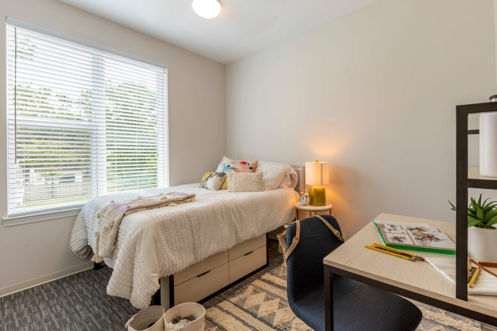 Bedroom with a view at UNCOMMON Wilmington in Wilmington, North Carolina