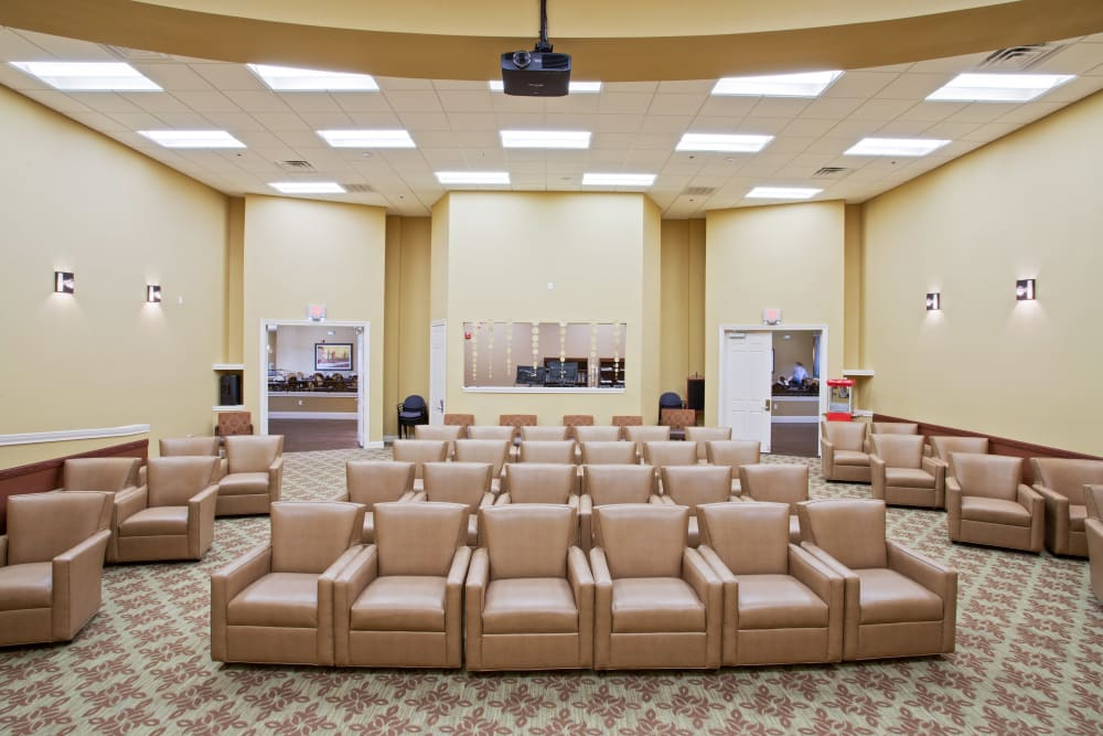 The community movie theater at Clayton Oaks Living in Richmond, Texas