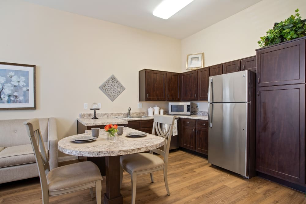 An apartment kitchen, living room and bedroom at Clayton Oaks Living in Richmond, Texas