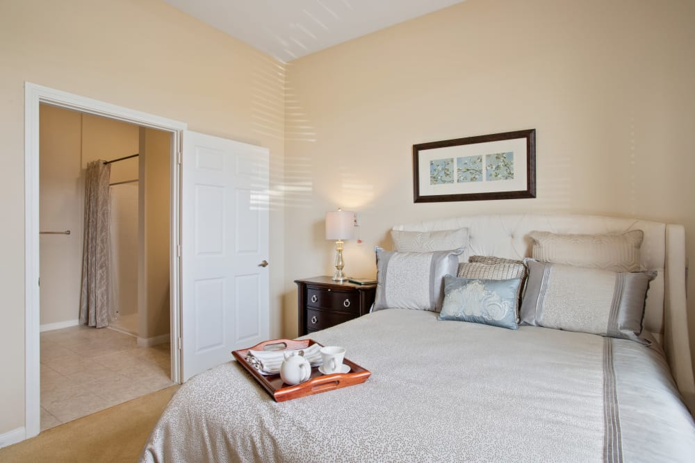An apartment bedroom at Clayton Oaks Living in Richmond, Texas