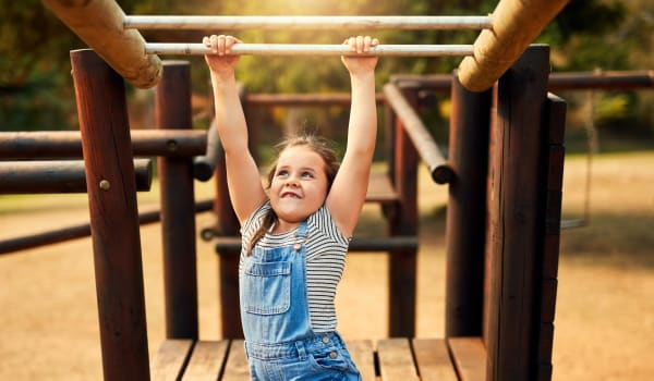 A young girl enjoying the playground at Park Village Apartments in Athens, Tennessee