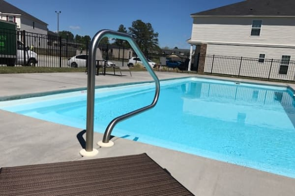 A resident swimming pool at The Village at Mill Creek in Statesboro, Georgia