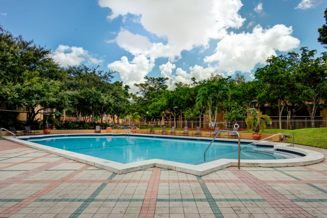 Beautiful swimming pool area at IMT Pinebrook Pointe in Margate, Florida