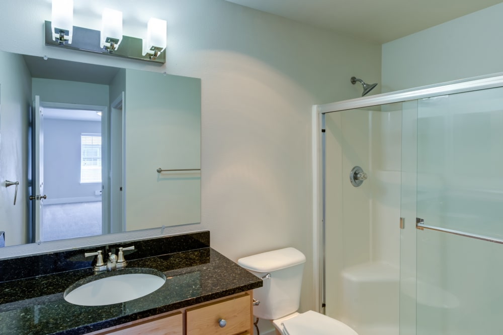 Modern and bright bathrooms at Bradley Park Apartments in Puyallup, Washington