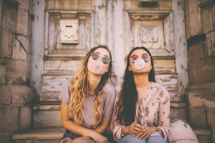 Girls blowing bubbles on a stoep downtown near Waterford Trails in Spring, Texas