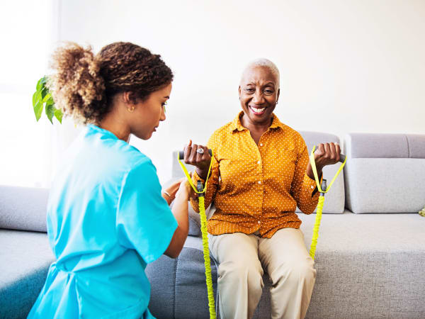 Nurse helping a resident stretch at Careage Home Health in Lakewood, Washington.