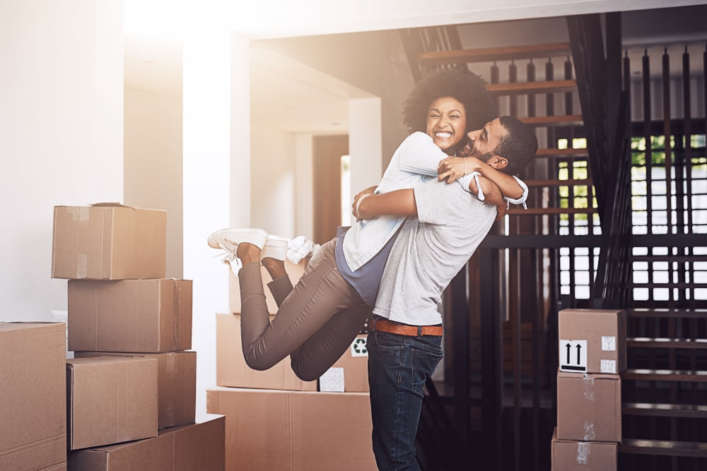 A couple hugging while moving boxes to store at Trojan Storage in Portland, Oregon