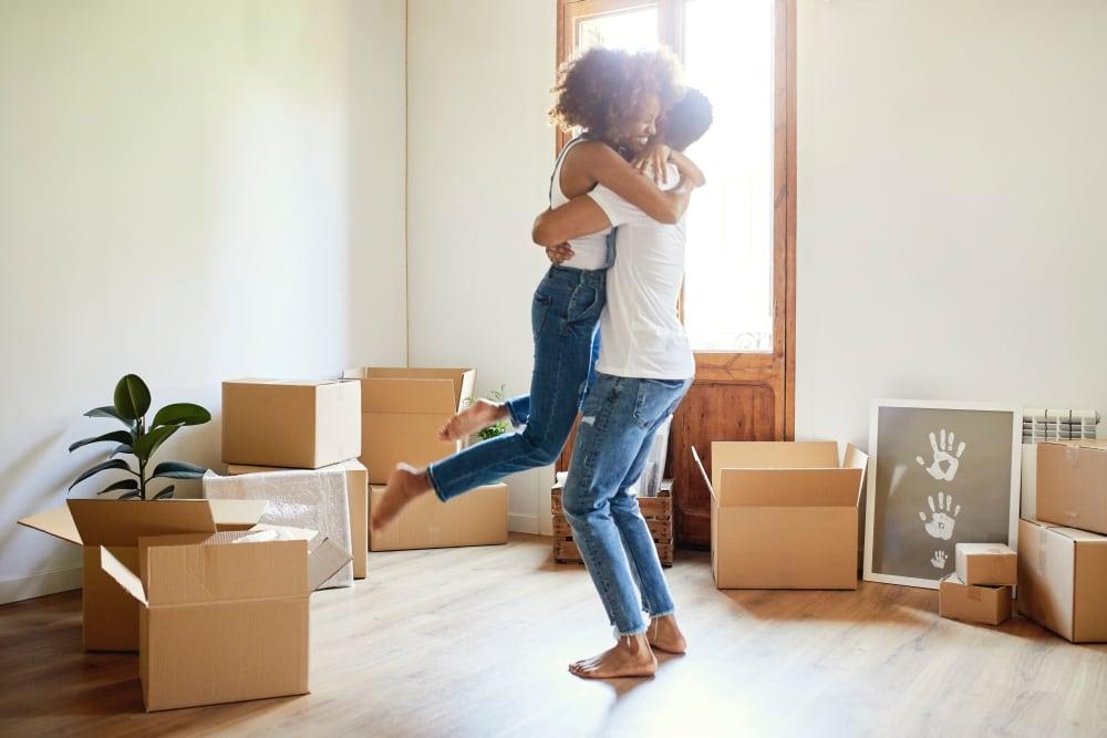A young couple hugging near Hayward Storage LLC in Hayward, California