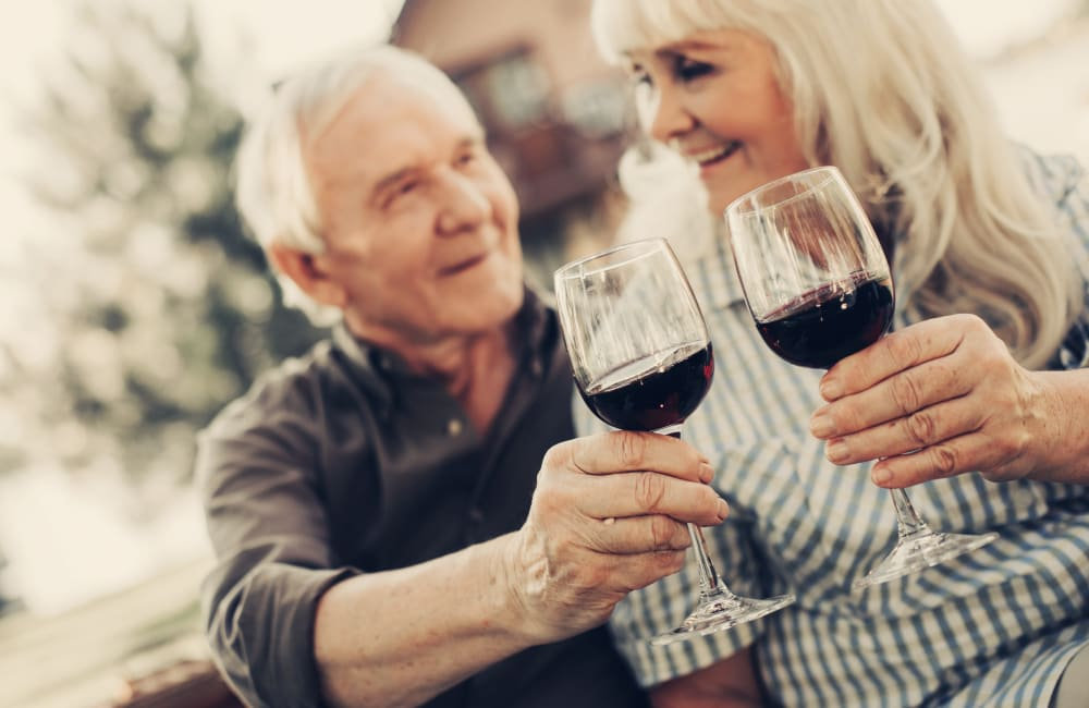 Resident couple toasting to their decision to live at Palo Alto Commons in Palo Alto, California