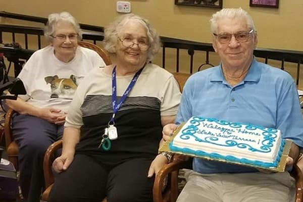 Happy residents with a cake at Lakeview Terrace of Boulder City