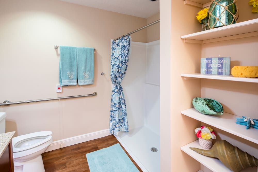 Resident bathroom with walk-in shower at The Springs At South Biscayne in North Port, Florida.