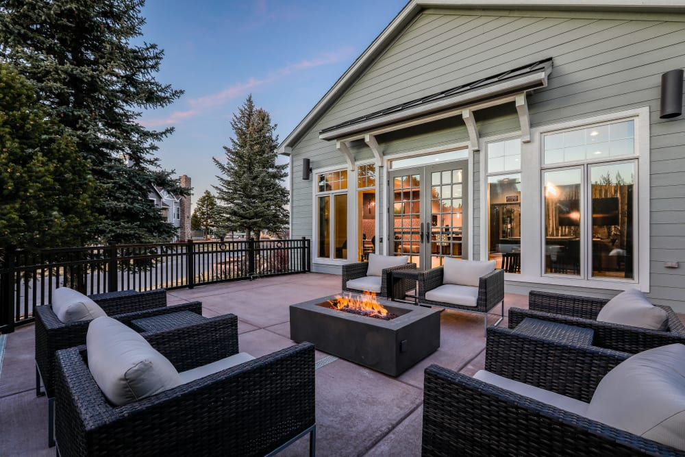 Patio with chairs an a fire pit at Marquis Castle Pines in Castle Pines, Colorado