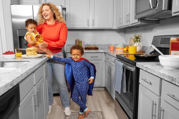 Resident and kids enjoying her kitchen at BB Living at Eastmark in Mesa, Arizona