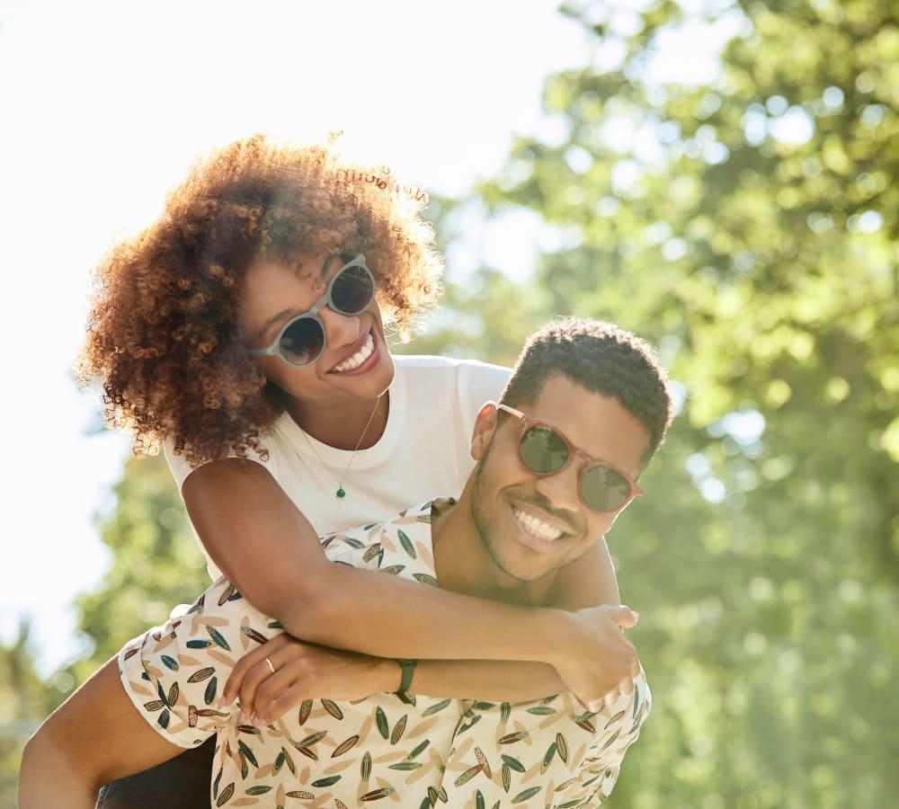 A happy couple enjoying the neighborhood near Sofi Danvers in Danvers, Massachusetts