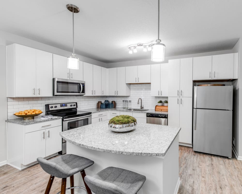 Bright and modern kitchen with a subway-tile backsplash in a model home at Canopy at Citrus Park in Tampa, Florida