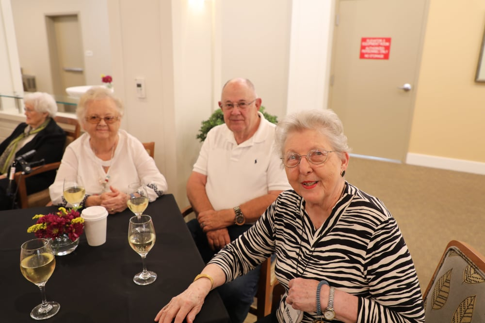Residents having dinner together at our senior living community