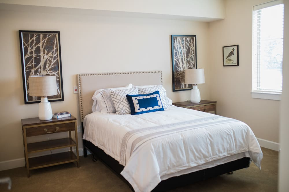 A spacious apartment bedroom at Touchmark at Fairway Village in Vancouver, Washington