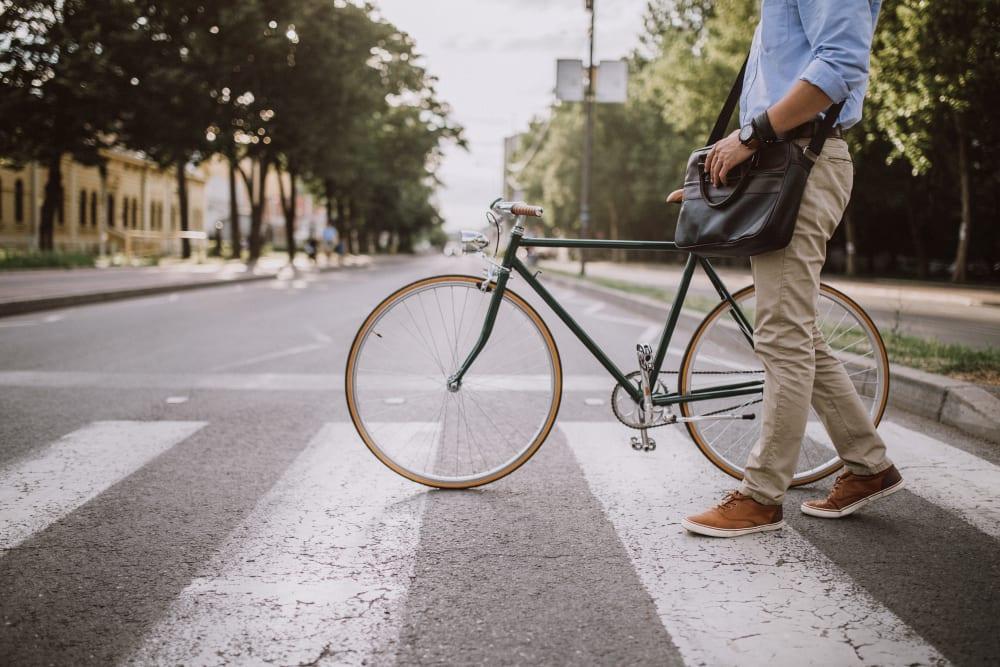 Man on a bike near Cypress Pointe Apartments in Gilroy, California
