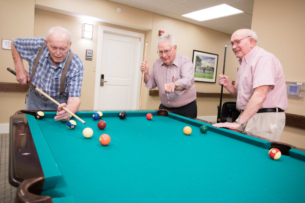 A group of residents playing billiards at The Heritage at Fountain Point in Norfolk, Nebraska