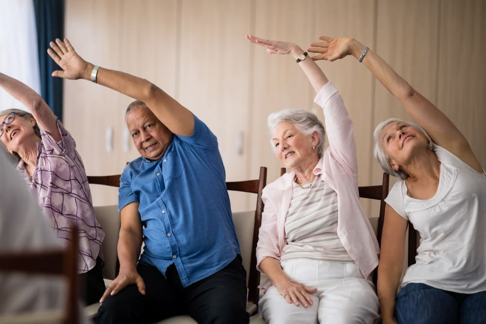 Residents enjoying an exercise class at Holden of Bellevue in Bellevue, Washington